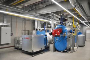 """<div class=""""bildtext_1"""">Drei Gasheizkessel mit fast 3MW Leistung erwärmen die neuen Gebäude.</div>"""