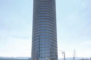"""<div class=""""bildtext_1"""">Das mit 100 m höchste Wohnhaus der Schweiz schafft auf 31 Stockwerken Raum für 218 Wohnungen, die im Herbst 2019 bezugsfertig sein sollen. Entworfen wurde der aussichtsreiche gläserne Gigant von Mike Sattler.</div>"""