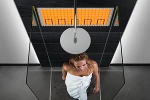 """<div class=""""bildtext_1"""">Die Beheizung der Wandfläche, beispielsweise innerhalb einer Dusche, ist ebenfalls möglich.</div>"""