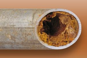 """<div class=""""bildtext_1"""">In durchschnittlich 70 Prozent aller Wasserleitungen hat sich eine Rost- und Kalkschicht abgelagert, die die Rohrstruktur schädigt.</div>"""