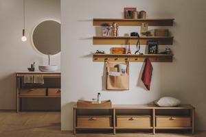 """<div class=""""bildtext_1"""">Wohnlichkeit: Warme Materialien wie Holz oder Textilien, Möbel, Teppiche oder auch eine dekorative Wand- und Bodengestaltung sind die Gestaltungskomponenten für ein wohnliches Private Spa.</div>"""