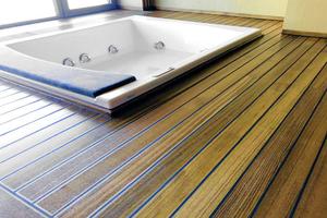 """<div class=""""bildtext_1"""">Durch die Beschichtung hat das vorher matte Holz einen leichten Glanz erhalten. Auch die Reinigung funktioniert einfach und einwandfrei.</div>"""