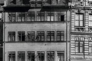 Die Gründer Emil Richter und Ernst Frenzel mit Mitarbeitern im Jahr 1895 vor dem Gründungshaus in Nürnberg<br />