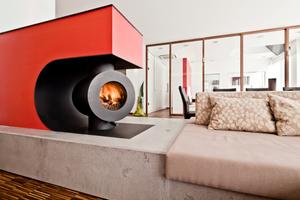 """<div class=""""bildtext_1"""">Den Sonderpreis für Trend erhält Andreas Zapfe für seinen drehbaren Ofeneinsatz mit Betonsitzbank als Raumteiler.</div>"""